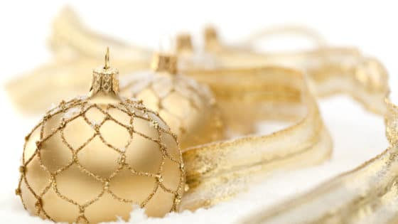 golden christmas baubles with decoration in snow